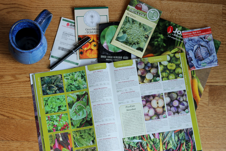 photos of a pile of free organic garden catalogs